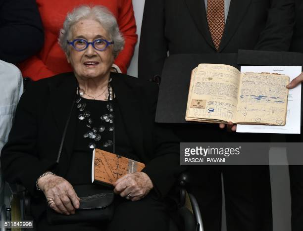 Marise CremieuxHurstel poses in Toulouse on February 23 next to the journal she started writing as a young girl during WWII which she donated to the...