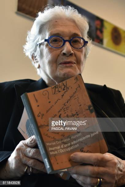 Marise CremieuxHurstel poses in Toulouse on February 23 with the journal she started writing as a young girl during WWII published by the publishing...