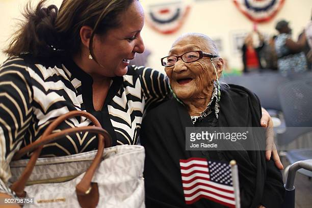 Marisela Chopite hugs her motherinlaw Juana Hernandez who is 101 years old and originally from Honduras after she had been sworn in as a naturalized...