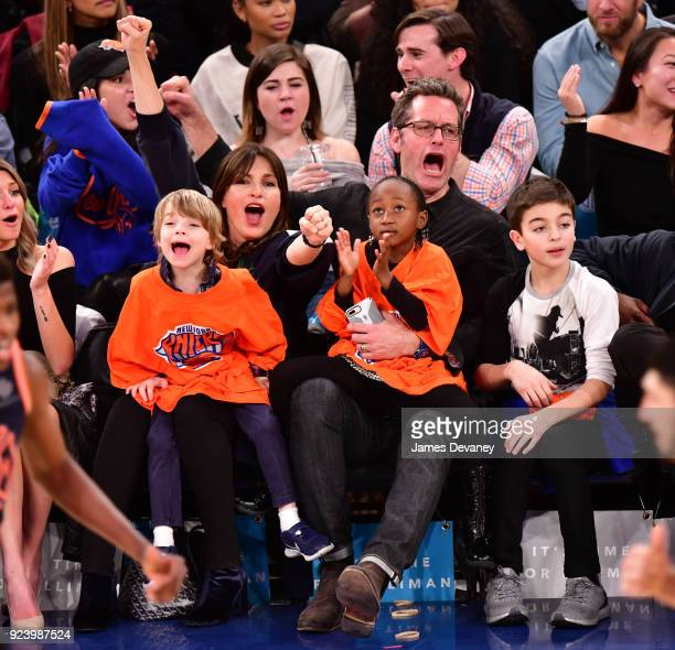 Mariska Hargitay and Peter Hermann sit courtside with children Amaya Hermann Andrew Hermann and August Hermann at the New York Knicks vs Boston...