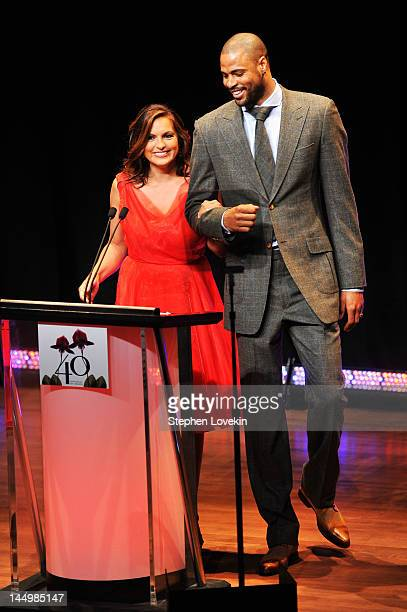Mariska Hargitay and Tyson Chandler speak onstage at the 40th annual Fifi awards at Alice Tully Hall Lincoln Center on May 21 2012 in New York City