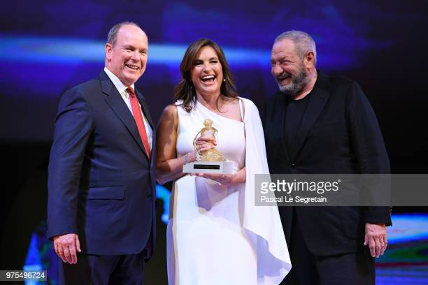 Mariska Hargitay poses with the Honorary Golden Nymph awards with Prince Albert II of Monaco and Dick Wolf during the opening ceremony of the 58th...