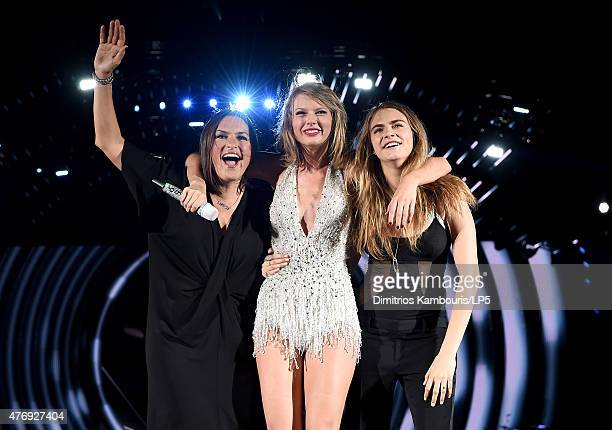 Mariska Hargitay Taylor Swift and Cara Delevingne pose onstage during The 1989 World Tour on June 12 2015 at Lincoln Financial Field in Philadelphia...