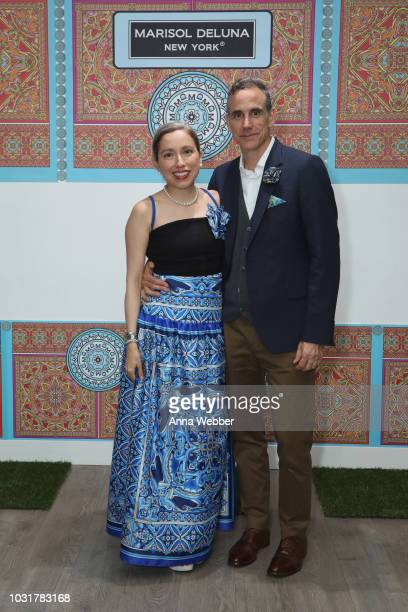 Marisol Deluna and Jonathan Cole pose after the Marisol Deluna New York Fashion Week presentation at Tals Studio on September 11 2018 in New York City