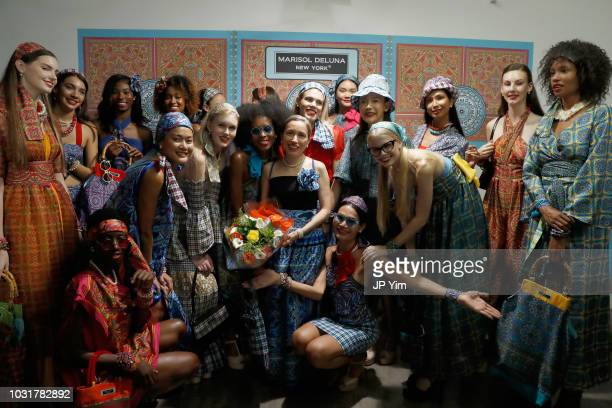 Marisol Deluna poses with models after the Marisol Deluna New York Fashion Week presentation at Tals Studio on September 11 2018 in New York City