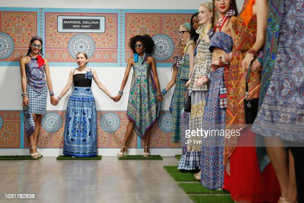 Marisol Deluna poses with models on the runway for the finale of the Marisol Deluna New York Fashion Week presentation at Tals Studio on September...