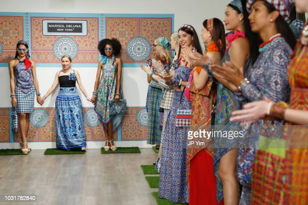 Marisol Deluna poses with models on the runway for the finale of the Marisol Deluna New York Fashion Week presentation at Tals Studio on September 11...