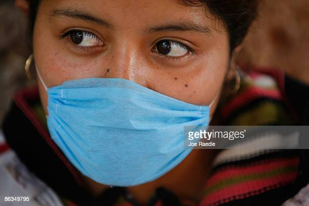 Marisol Lopez wears a surgical mask to help prevent contamination with the swine flu May 2 2009 in Mexico City Mexico The Mexican government...