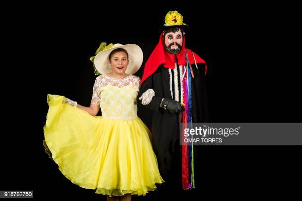 Marisol Montanegre and Oswaldo Flores pose in their Catrines costumes for the carnival in Tlaxcala Mexico on February 13 2018 The satirical costumes...