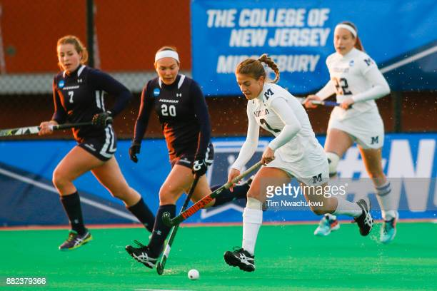 Marissa Baker of Middlebury College pushes the ball downfield during the Division III Women's Field Hockey Championship held at Trager Stadium on...
