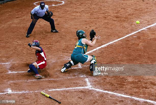 Marissa Carpadios of Australia waits for a ball as Andrea Duran of USA runs to the home plate during the ISF XI Women's Fast Pitch Softball World...