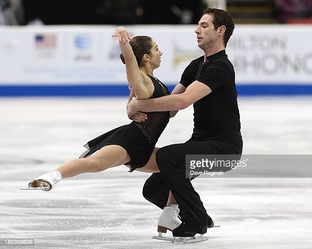 Marissa Castelli and Simaon Schnapir of the USA perform during the pairs short program of day two at Skate America at Joe Louis Arena on October 19...