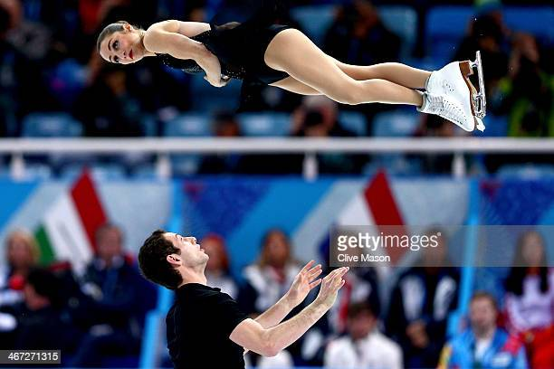 Marissa Castelli and Simon Shnapir of the United States compete in the Figure Skating Pairs Short Program during the Sochi 2014 Winter Olympics at...