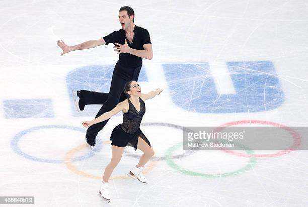 Marissa Castelli and Simon Shnapir of the United States compete during the Figure Skating Pairs Short Program on day four of the Sochi 2014 Winter...