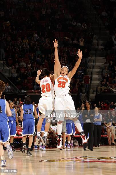 Marissa Coleman and Kristi Toliver of the Maryland Terrapins celebrate after scoring against the Duke Blue Devils at the Comcast Center on February...