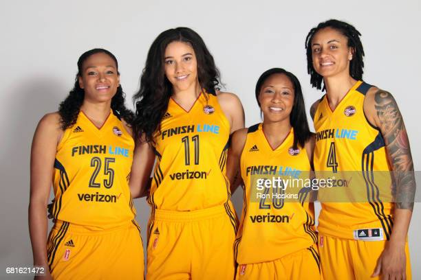 Marissa Coleman, Natalie Achonwa, Briann January, and Candice Dupree of the Indiana Fever poses for a portrait during Media Day at Bankers Life...