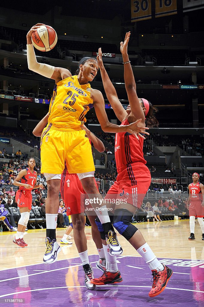 Marissa Coleman #25 of the Los Angeles Sparks grabs the rebound against Kia Vaughn #9 of the Washington Mystics at Staples Center on June 23, 2013 in Los Angeles, California.