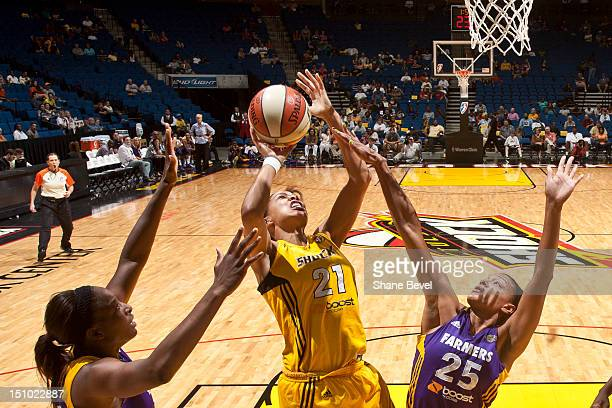 Marissa Coleman of the Los Angeles Sparks tries to block a shot by Jennifer Lacy of the Tulsa Shock during the WNBA game on August 30 2012 at the BOK...