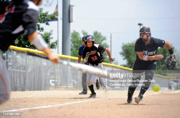 Marissa Gagliano of the Bandits runs in to score after the bunt by Aspyn NovakThe Beverly Bandits JT beat the Tennessee Fury '97 team to win the...