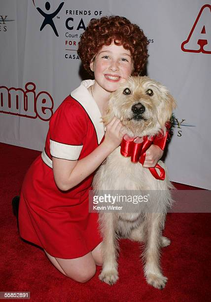 Marissa O'Donnell and Sandy pose at the opening of 'Annie' at the Pantages Theartre on October 4 2005 in Los Angeles California