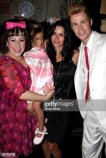Marissa Perry as 'Tracy Turnblad' Coco Riley Arquette mom Courteney Cox and Ashley Parker Angel as 'Link Larkin' pose backstage at 'Hairspray' on...