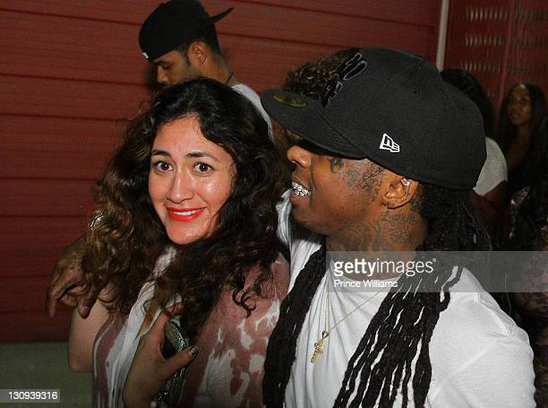 Marissa Torres and Lil Wayne leave the Lil Wayne I Am Music II Tour AfterParty at Compound on April 9 2011 in Atlanta Georgia