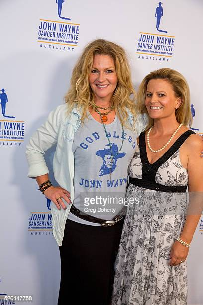 Marissa Wayne and Melanie Wayne attend the John Wayne Odyssey Ball at the Beverly Wilshire Four Seasons Hotel on April 9 2016 in Beverly Hills...
