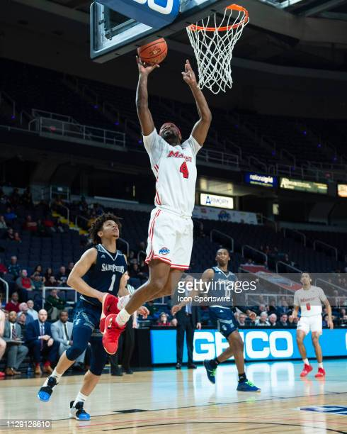 Marist Red Foxes Forward Isaiah Lamb shoots a layup during the second half between the Saint Peter's Peacocks and the Marist Red Foxes on March 7 at...