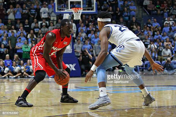 Marist Red Foxes guard Khallid Hart and Rhode Island Rams guard Christion Thompson in action during the first half of an NCAA basketball game between...
