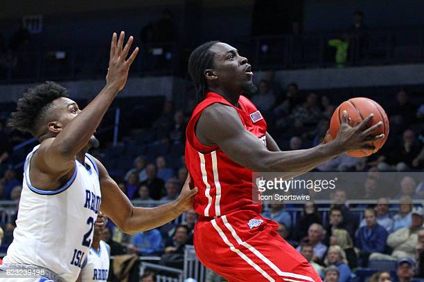 Marist Red Foxes guard Khallid Hart pursued by Rhode Island Rams forward Mike Layssard during the second half of an NCAA basketball game between the...
