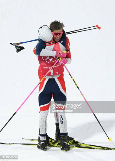 Marit Bjoergen and Johannes Hoesflat of Norway celebrate winning gold after the Cross Country Men's Team Sprint Free Final on day 12 of the...