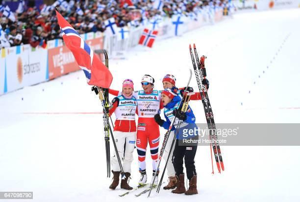 Marit Bjoergen, Maiken Caspersen Falla, Heidi Weng and Astrid Uhrenholdt Jacobsen of Norway celebrate as they win gold during the Women's Cross...
