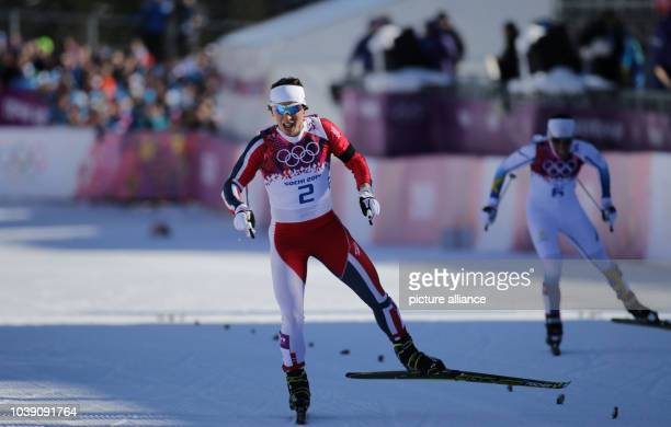 Marit Bjoergen of Norway and Charlotte Kalla compete in the Ladies' Skiathlon 75 km Classic 75 km Free in Laura Crosscountry Ski Biathlon Center at...