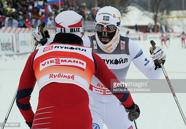 Marit Bjoergen of Norway and Charlotte Kalla of Sweden celebrate after crossing the finish line following the FIS World Cup Crosscountry women's 10...