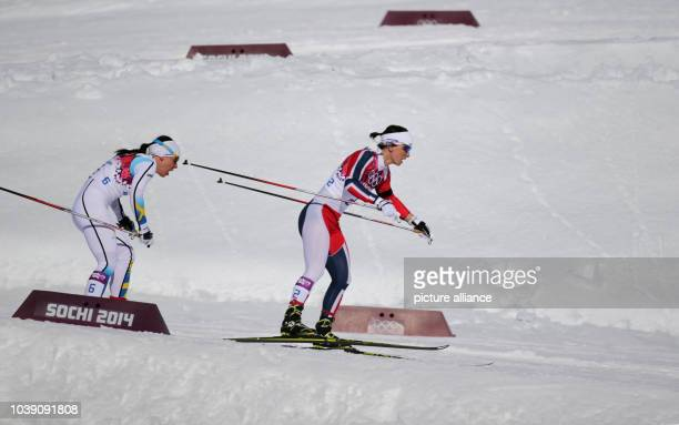 Marit Bjoergen of Norway and Charlotte Kalla of Sweden compete in the Ladies' Skiathlon 75 km Classic 75 km Free in Laura Crosscountry Ski Biathlon...