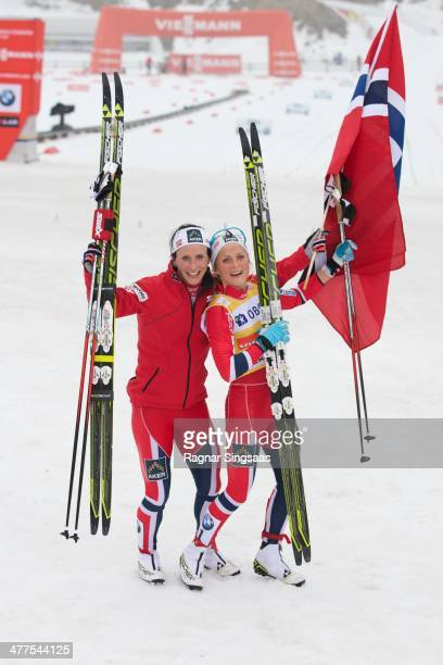Marit Bjoergen of Norway and Therese Johaug of Norway celebrate during the FIS CrossCountry World Cup Ladies 30 km Mass Start Classic on March 9 2014...