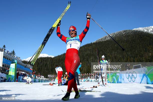 Marit Bjoergen of Norway celebrates after she finished first to win the gold medal in the Women's Individual Sprint C Final on day 6 of the 2010...