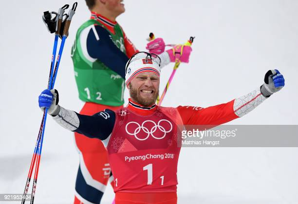 Marit Bjoergen of Norway celebrates as he wins gold alongside Johannes Hoesflat of Norway during the Cross Country Men's Team Sprint Free Final on...