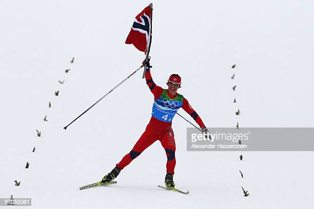Marit Bjoergen of Norway celebrates as Norway win the gold medal during the Ladies' Cross Country 4x5 km Relay on day 14 of the 2010 Vancouver Winter...