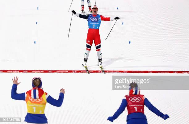 Marit Bjoergen of Norway celebrates as she crosses the finish line to win gold during the Ladies' 4x5km Relay on day eight of the PyeongChang 2018...