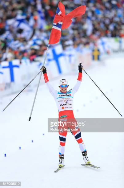 Marit Bjoergen of Norway celebrates as she crosses the line to win gold during the Women's Cross Country 4x5km Relay at the FIS Nordic World Ski...