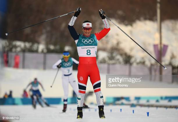 Marit Bjoergen of Norway celebrates crossing the finish line to win silver during the Ladies Cross Country Skiing 75km 75km Skiathlon on day one of...