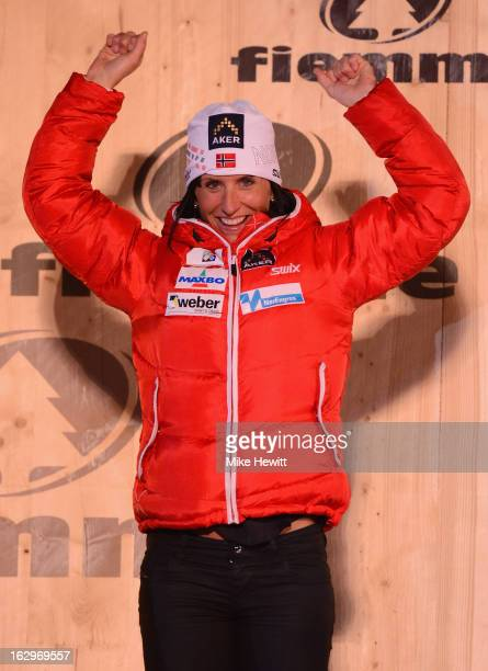 Marit Bjoergen of Norway celebrates her Gold medal on the podium at the medal ceremony for the Women's Cross Country Mass Start 30Km at the FIS...
