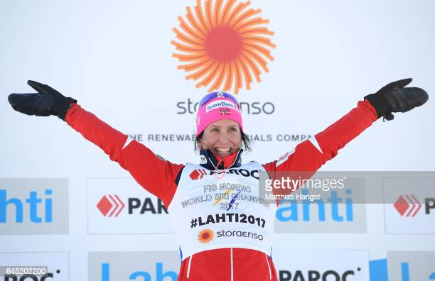 Marit Bjoergen of Norway celebrates her gold medal win during the flower ceromeny after the Women's Cross Country Skiathlon during the FIS Nordic...