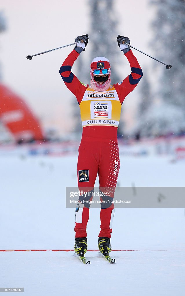Marit Bjoergen of Norway celebrates her victory in the women 10km free handicap start during the FIS World Cup Cross Country Skiing on November 28, 2010, in Kuusamo, Finland.
