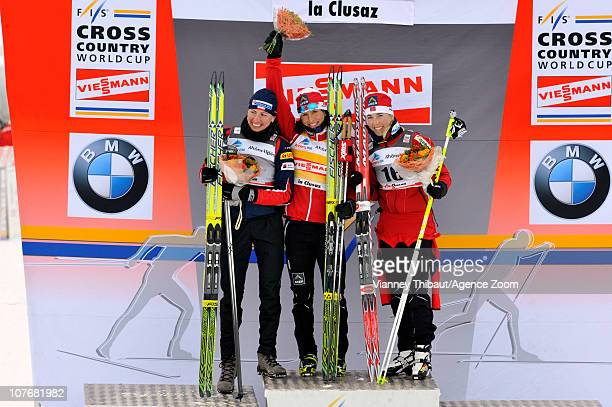 Marit Bjoergen of Norway celebrates taking 1st place Justyna Kowalczyk of Poland 2nd place and Kristin Stoermer Steira of Norway 3rd place on the...