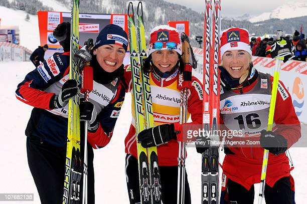 Marit Bjoergen of Norway celebrates taking 1st place Justyna Kowalczyk of Poland 2nd place and Kristin Stoermer Steira of Norway 3rd place after the...
