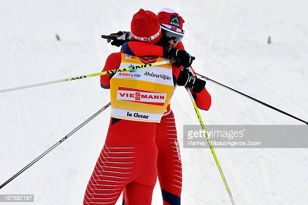 Marit Bjoergen of Norway celebrates taking 1st place with Kristin Stoermer Steira of Norway who took 3rd place during the FIS CrossCountry World Cup...