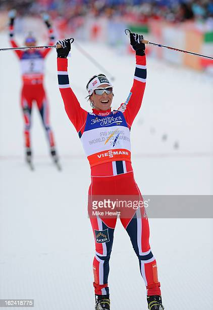 Marit Bjoergen of Norway celebrates victory as she crosses the finish line during the Women's Skiathlon 75km at the FIS Nordic World Ski...