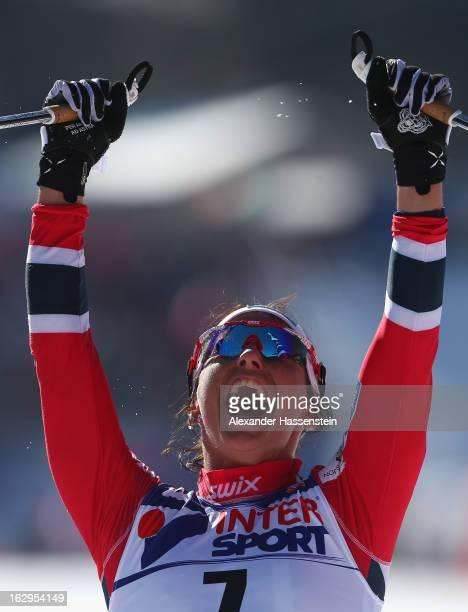 Marit Bjoergen of Norway celebrates victory during the Women's Cross Country Mass Start 30Km at the FIS Nordic World Ski Championships on March 2,...